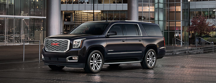 2015 Yukon Denali XL full size extended luxury SUV with polished chrome wheels and grill.